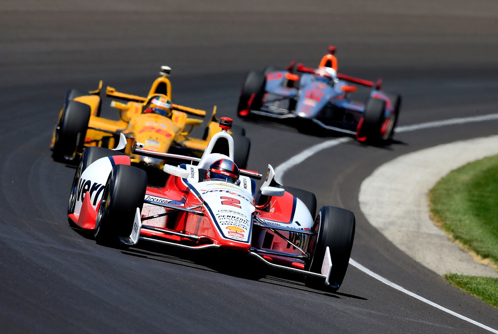 . Juan Pablo Montoya of Columbia, driver of the #2 Verizon Team Penske Chevrolet Dallara, leads a pack of cars during the 98th running of the Indianapolis 500 at Indianapolis Motorspeedway on May 25, 2014 in Indianapolis, Indiana.  (Photo by Jamie Squire/Getty Images)