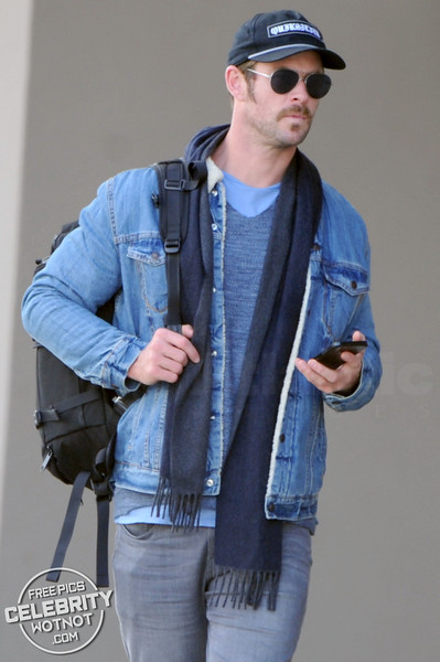 EXCLUSIVE: Chris Hemsworth Lands In Vancouver In Double Denim + A 60's Mustache!