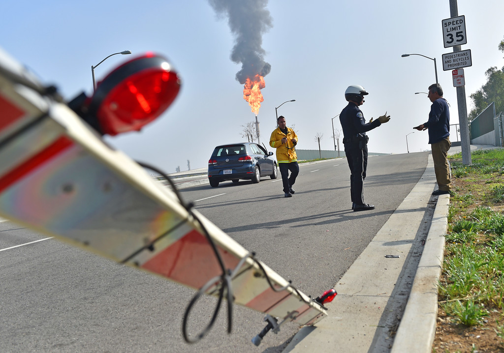 . Broken barrier after motorist crashed through along Del Amo Blvd. Exxon/Mobil fire and hazmat incident at Torrance refinery. Only a few minor injuries.  (02/18/15 Photos by Brad Graverson/The Daily Breeze)