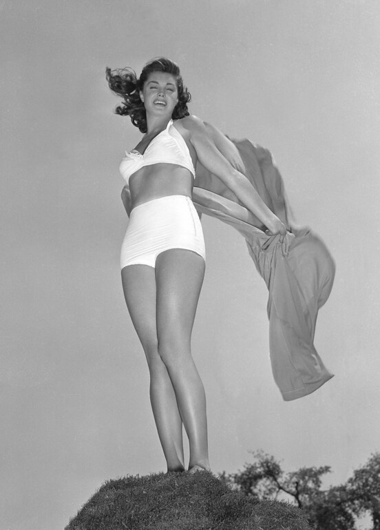 ". Esther Williams, the theme girl of the first annual Los Angeles Swimming and Diving Contest to be held in September 1942, is seen in this August 1942 photo. Williams was a swimming champion who turned to acting where she was able to use her aquatic skills in such films as ""Easy to Wed,\"" \""Neptune\'s Daughter\"" and \""Dangerous When Wet.\"" (AP Photo)"