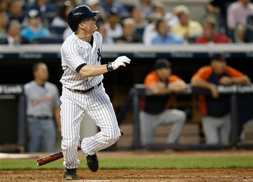 . New York Yankees\' Brendan Ryan watches a third-inning double in a baseball game against the Detroit Tigers at Yankee Stadium in New York, Tuesday, Aug. 5, 2014. (AP Photo/Kathy Willens)