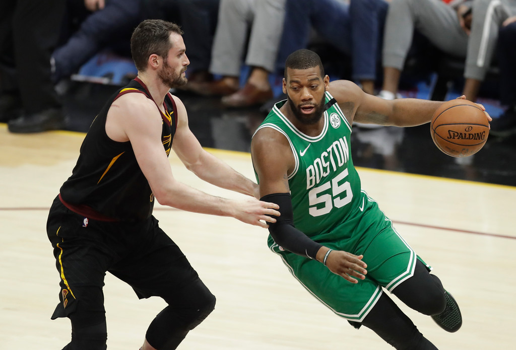 . Boston Celtics\' Greg Monroe (55) drives against Cleveland Cavaliers\' Kevin Love (0) in the first half of Game 3 of the NBA basketball Eastern Conference finals, Saturday, May 19, 2018, in Cleveland. (AP Photo/Tony Dejak)