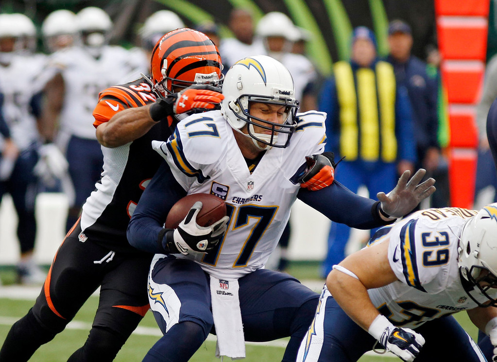 . San Diego Chargers quarterback Philip Rivers (17) is sacked by Cincinnati Bengals safety Chris Crocker in the first half of an NFL wild-card playoff football game Sunday, Jan. 5, 2014, in Cincinnati. (AP Photo/David Kohl)