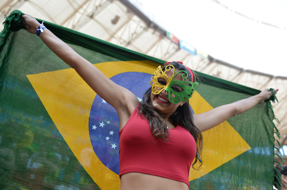 . A fan cheers prior to the Group G football match between Portugal and Ghana at the Mane Garrincha National Stadium in Brasilia during the 2014 FIFA World Cup on June 26, 2014. (CARL DE SOUZA/AFP/Getty Images)