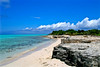 Photography of a beautiful stetch of tropical shoreline covered with limestone.