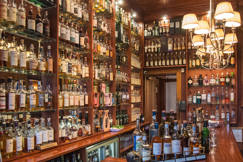 Over 350 different bottles of Scotch whisky at the hotel bar.