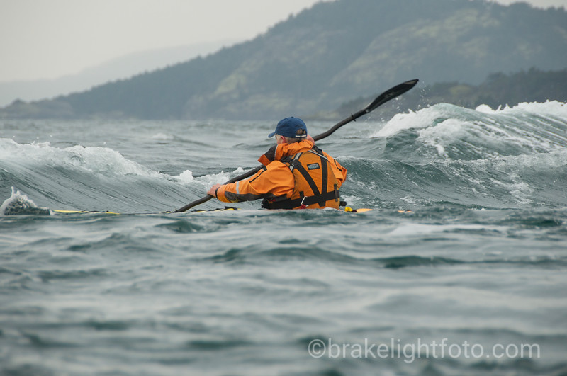 Kayaker Surfing a Tide Rip