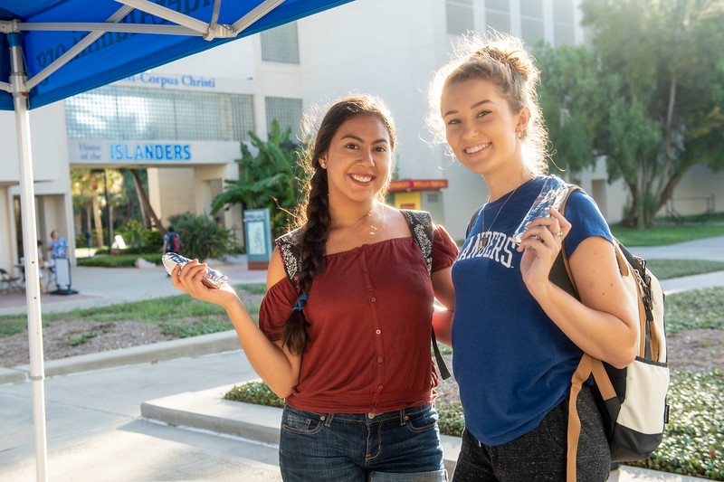 Katrina Garcia (left) and Caitlynn Partin make a quick stop for breakfast tacos at the Alumni Association's Taco Tuesday event.