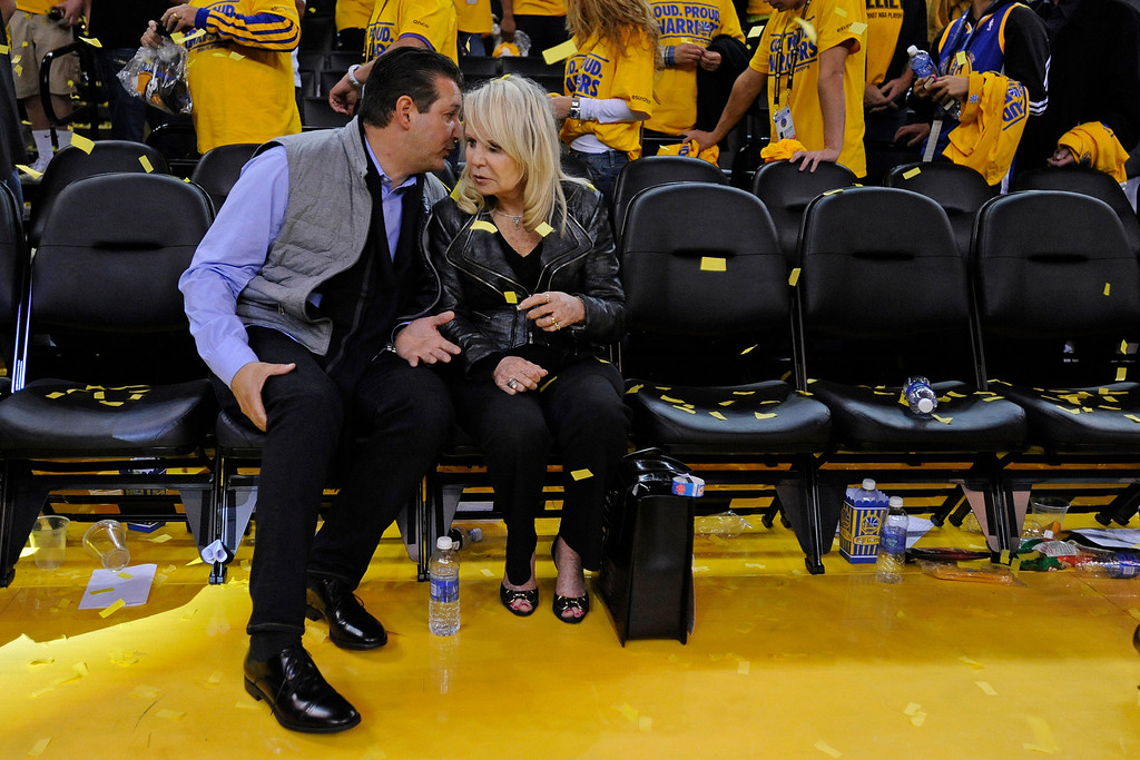 . An unidentified man talks to Rochelle Sterling, wife of Donald Sterling, owner of the Los Angeles Clippers after Game 4 of their Western Conference NBA playoff at Oracle Arena in Oakland, Calif., on Sunday, April 27, 2014. The Warriors defeated the Clippers 118-97. (Jose Carlos Fajardo/Bay Area News Group)