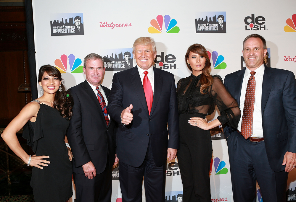 "Description of . Donald Trump  and Melania Trump (C) attend ""All Star Celebrity Apprentice\"" Finale at Cipriani 42nd Street on May 19, 2013 in New York City.  (Photo by Robin Marchant/Getty Images)"