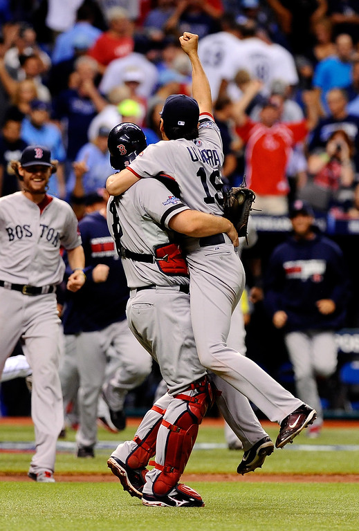 . Koji Uehara #19 and David Ross #3 of the Boston Red Sox celebrate after the Boston Red Sox defeated the Tampa Bay Rays 3-1 in Game Four of the American League Division Series at Tropicana Field on October 8, 2013 in St Petersburg, Florida.  (Photo by Brian Blanco/Getty Images)