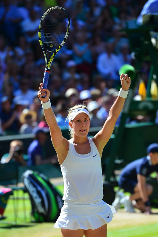 . Canada\'s Eugenie Bouchard celebrates winning her women\'s singles semi-final match against Romania\'s Simona Halep on day ten of the 2014 Wimbledon Championships at The All England Tennis Club in Wimbledon, southwest London, on July 3, 2014. Bouchard won 7-6, 6-2.   CARL COURT/AFP/Getty Images