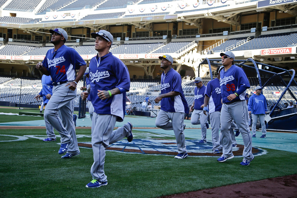 . Los Angeles Dodgers players warmup prior to batting practice preceeding their baseball game against the San Diego Padres in San Diego, Wednesday, April 10, 2013. (AP Photo/Lenny Ignelzi)