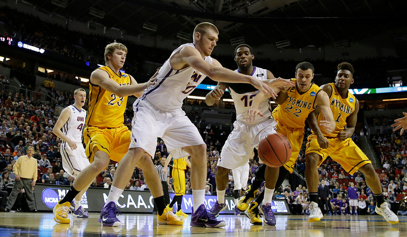 . Northern Iowa\'s Seth Tuttle, third from left, and Marvin Singleton, third from right, battle for a loose ball with Wyoming\'s Charles Hankerson Jr., right, and Larry Nance Jr., second from right, during the first half of an NCAA tournament college basketball game in the Round of 64 in Seattle, Friday, March 20, 2015. (AP Photo/Ted S. Warren)
