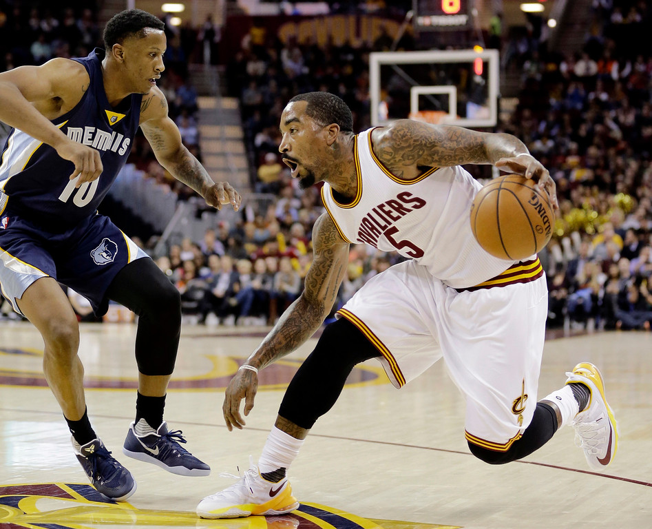 . Cleveland Cavaliers\' J.R. Smith (5) drives past Memphis Grizzlies\' Troy Williams (10) in the first half of an NBA basketball game Tuesday, Dec. 13, 2016, in Cleveland. (AP Photo/Tony Dejak)