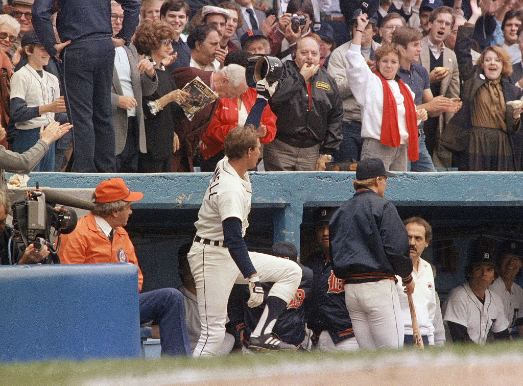 . Detroit Tigers shortstop Alan Trammell, second from left, waves to the crowd from the top step of the dugout after a two run homerun against the Padres in the 1984 World Series. (AP Photo)