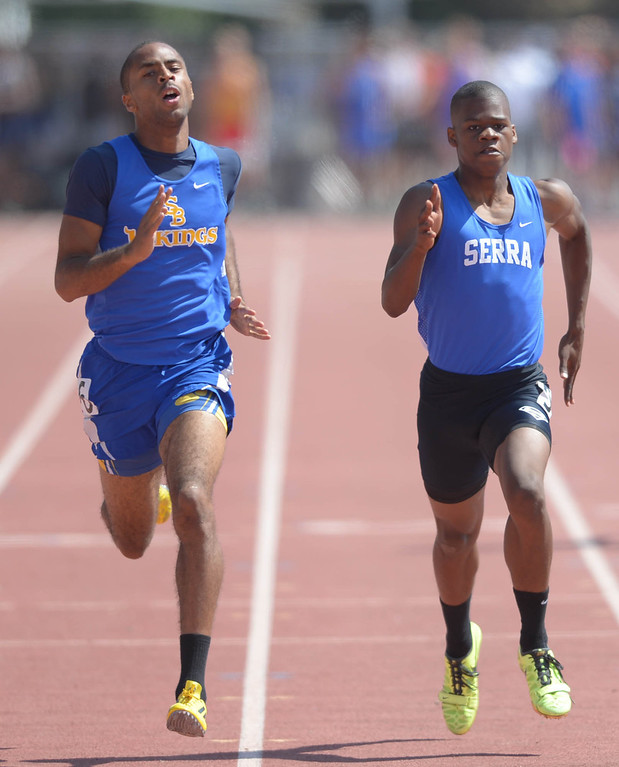 . St. Bernard\'s Daniel Mouton and Serra\'s Ronny Hall are stride for stride in the 400 meter Division 4 race of the CIF Southern Section Track and Field Championships Saturday at Mt. SAC. Mouton would win at the line. 20130518 Photo by Steve McCrank / Staff Photographer