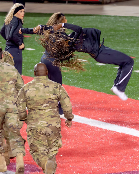 Cheerleader doing a touchdown backflip