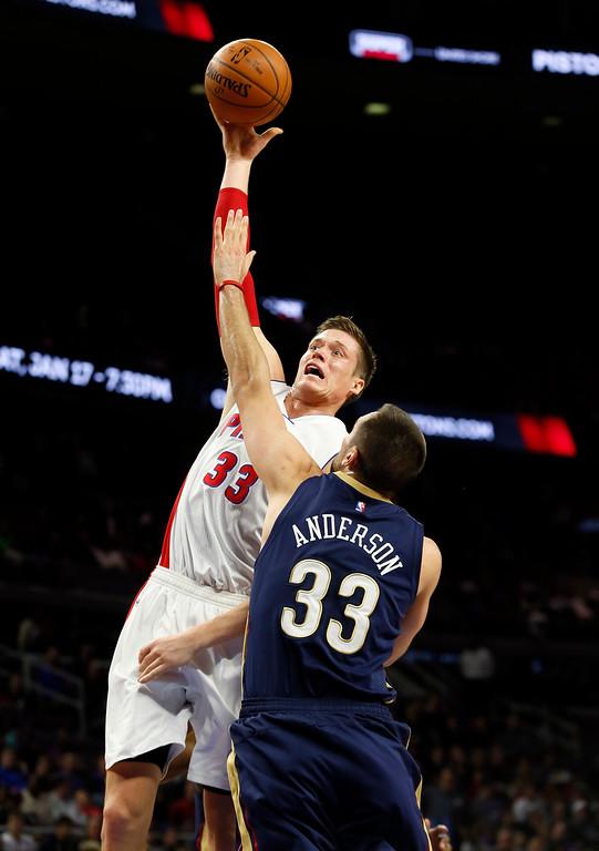 . Detroit Pistons forward Jonas Jerebko (33) drives on New Orleans Pelicans forward Ryan Anderson (33) in the first half of an NBA basketball game in Auburn Hills, Mich., Wednesday, Jan. 14, 2015. (AP Photo/Paul Sancya)