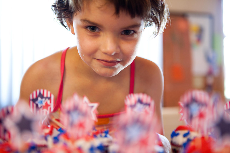 kyah and the cupcakes with flags.jpg