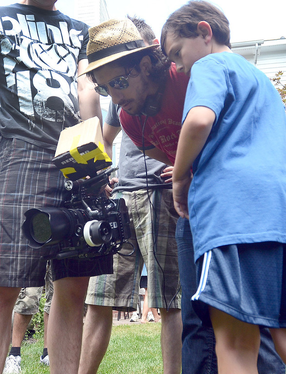 ". Director Michael Angelo Zervos (left) and Evan Kole, who is the young lead in the movie ""Papou,\"" look at a scene that was shot on location at a home in Novi, Thursday July 25, 2013. (Oakland Press Photo:Vaughn Gurganian)"