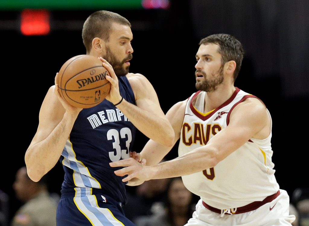 . Memphis Grizzlies\' Marc Gasol (33), from Spain, drives against Cleveland Cavaliers\' Kevin Love (0) in the first half of an NBA basketball game, Saturday, Dec. 2, 2017, in Cleveland. (AP Photo/Tony Dejak)