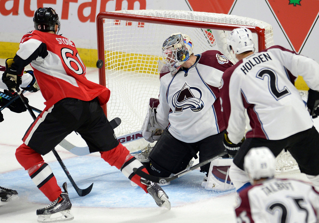 . Colorado Avalanche goaltender Calvin Picard reacts on a goal by Ottawa Senators\' David Legwand, not seen, as Senators\' Mark Stone (61) watches during the second period of an NHL hockey game Thursday, Oct. 16, 2014, in Ottawa, Ontario. (AP Photo/The Canadian Press, Justin Tang)