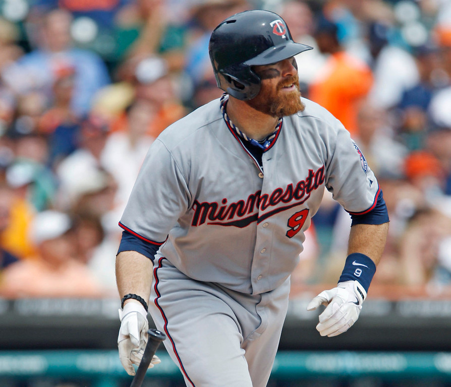 . Minnesota\'s Ryan Doumit watches his three-run home run disappear over the right center wall on a curveball off  Tigers starter Justin Verlander in the fifth inning. (AP Photo/Duane Burleson)