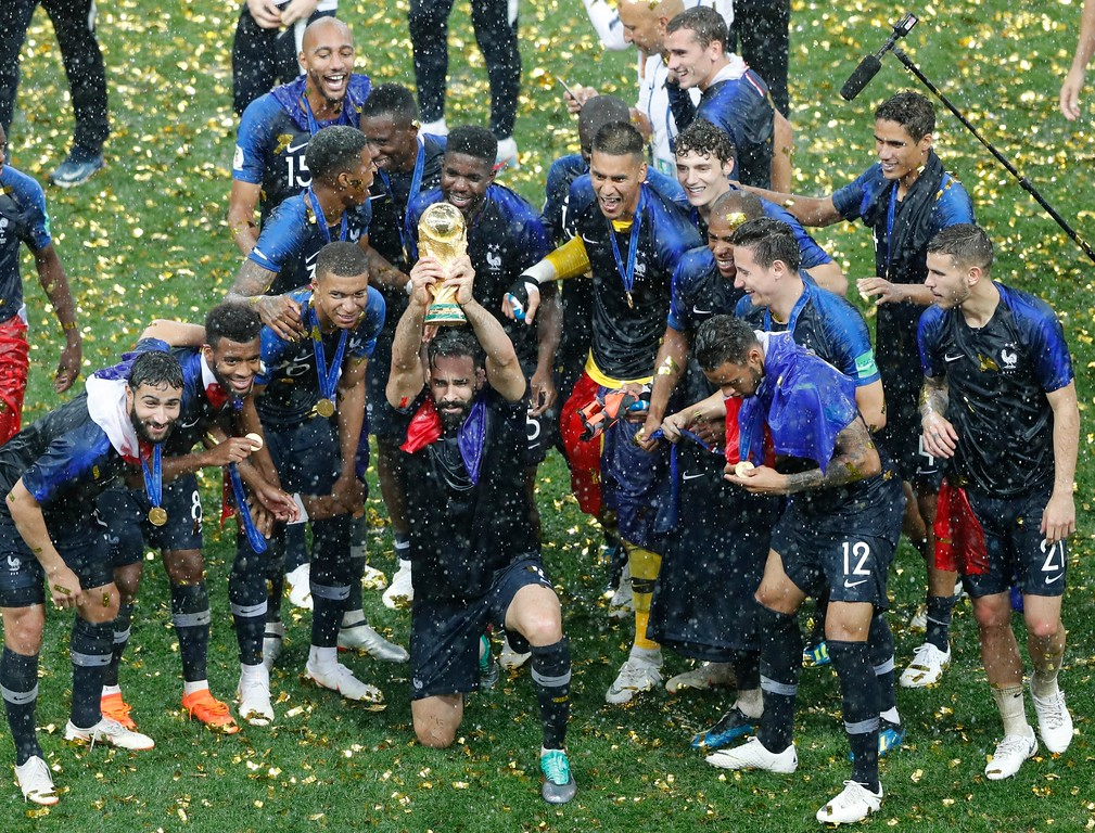. French players celebrate with the trophy at the end of the final match between France and Croatia at the 2018 soccer World Cup in the Luzhniki Stadium in Moscow, Russia, Sunday, July 15, 2018. France won 4-2. (AP Photo/Frank Augstein)