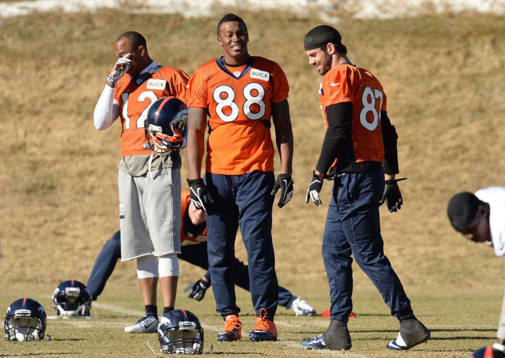 . From left, Denver Broncos Andre Caldwell (12), Demaryius Thomas (88) and Eric Decker (87) are warming up for the team practice at Dove Valley. Centennial Colorado. January 17. 2014. (Photo by Hyoung Chang/The Denver Post)