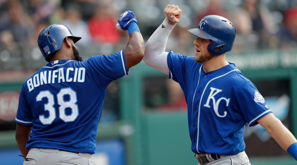 . Kansas City Royals\' Hunter Dozier, right, is congratulated by Jorge Bonifacio after hittinga solo home run in the eighth inning of a baseball game, Monday, Sept. 3, 2018, in Cleveland. (AP Photo/Tony Dejak)
