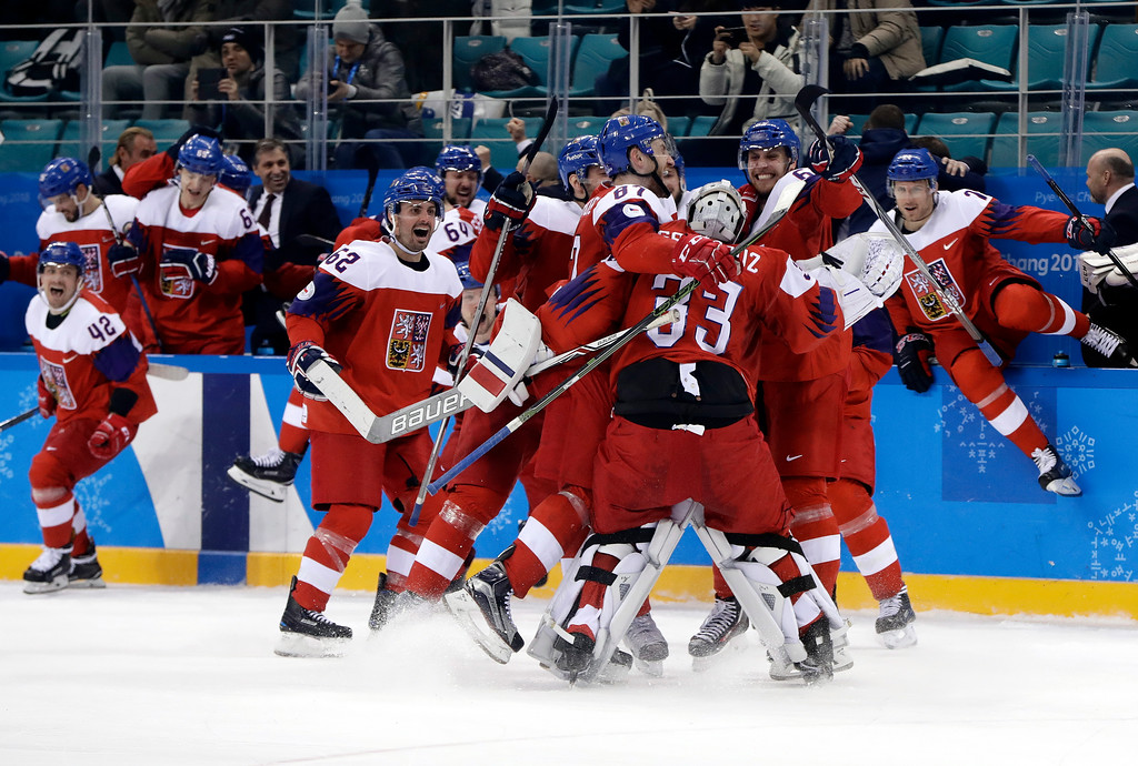 . the Czech Republic players celebrate after the quarterfinal round of the men\'s hockey game against the United States at the 2018 Winter Olympics in Gangneung, South Korea, Wednesday, Feb. 21, 2018. The Czech Republic won 3-2. (AP Photo/Matt Slocum)