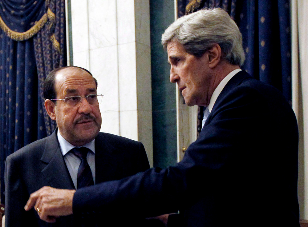 . U.S. Secretary of State John Kerry, right meets with Iraq\'s Prime Minister Nouri al-Maliki in Baghdad, Iraq, Sunday, March 24, 2013. U.S. Secretary of State John Kerry made an unannounced visit to Iraq on Sunday and will urge Prime Minister Nouri al-Maliki to make sure Iranian flights over Iraq do not carry arms and fighters to Syria, a U.S. official said. (AP Photo/Jason Reed, Pool)