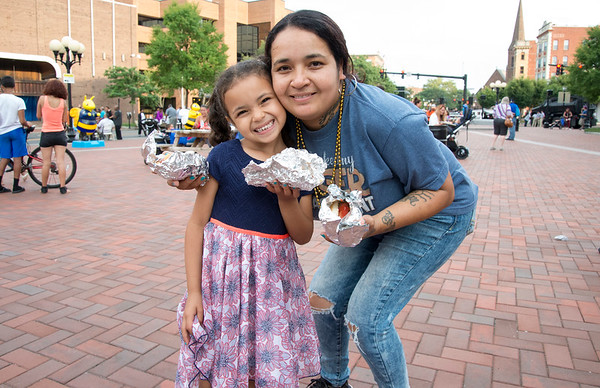 08/06/19 Wesley Bunnell | Staff The New Britain and CCSU Police held National Night out in Central Park on Tuesday evening as part of a nationwide night out designed to foster camaraderie between police and local communities. Serenity Soto, age 5, is all smiles as she poses for a photo with her mother Rosa Roldan.