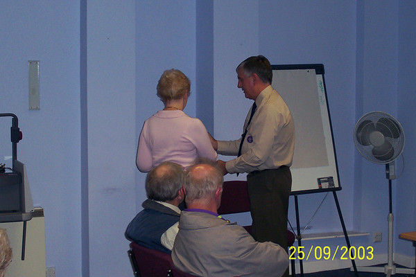2003-09-25 Mike, Irene & Maureen Receiving their Medals of Merit from the District