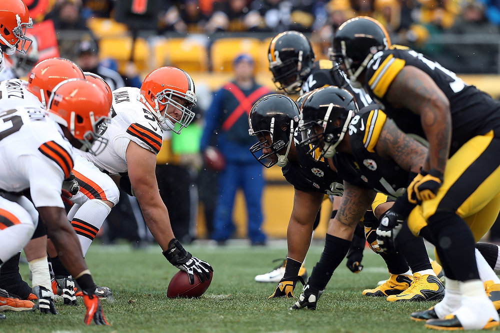 Description of . Alex Mack #55 of the Cleveland Browns lines up against Casey Hampton #98 of the Pittsburgh Steelers during their game at Heinz Field on December 30, 2012 in Pittsburgh, Pennsylvania.  (Photo by Karl Walter/Getty Images)