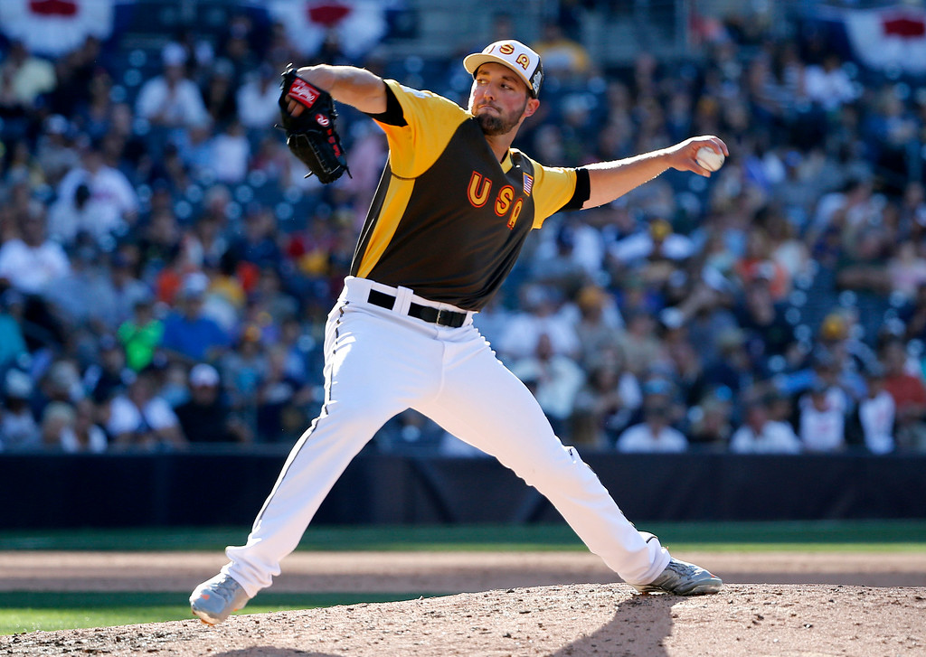 . U.S. Team\'s Nate Smith, of the Los Angeles Angels, throws against the World Team during the sixth inning of the All-Star Futures baseball game, Sunday, July 10, 2016, in San Diego. (AP Photo/Lenny Ignelzi)