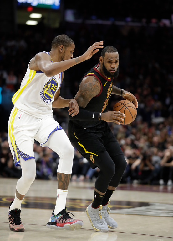 . Cleveland Cavaliers\' LeBron James is defended by Golden State Warriors\' Kevin Durant in the second half of Game 3 of basketball\'s NBA Finals, Wednesday, June 6, 2018, in Cleveland. (AP Photo/Tony Dejak)
