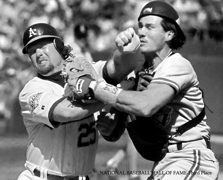 The Oakland A's Mark McGwire is out at home, colliding with catcher Pat Borders of the Toronto Blue Jays.  Hayward Daily Review/Dino Vournas