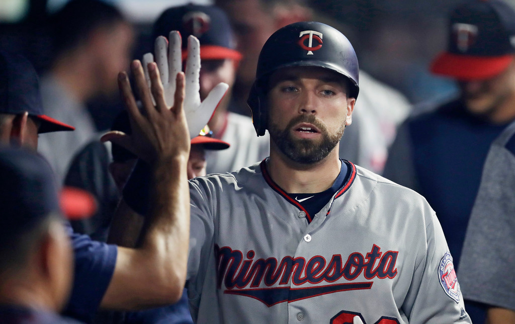 . Minnesota Twins\' Jake Cave is congratulated by teammates after hitting a solo home run off Cleveland Indians relief pitcher Dan Otero in the ninth inning of a baseball game, Tuesday, Aug. 28, 2018, in Cleveland. The Indians won 8-1. (AP Photo/Tony Dejak)
