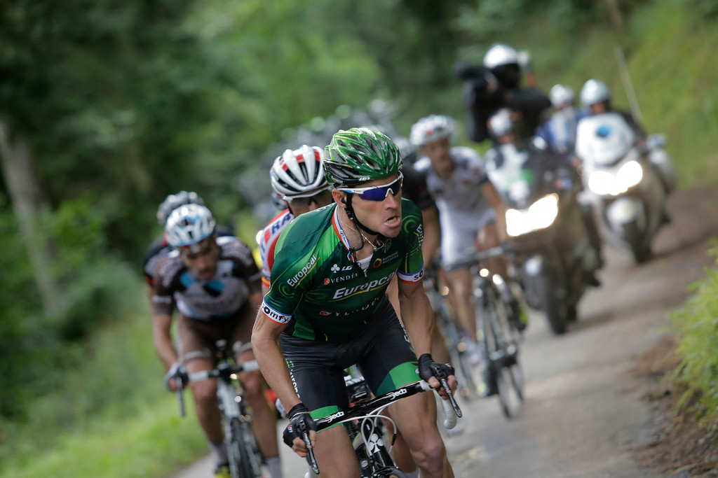 . Thomas Voeckler of France leads the breakaway during the tenth stage of the Tour de France cycling race over 161.5 kilometers (100.4 miles) with start in Mulhouse and finish in La Planche des Belles Filles, France, Monday, July 14, 2014. (AP Photo/Laurent Cipriani)