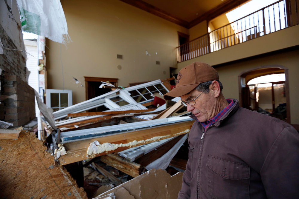 Description of . Ted Williams surveys the damage to his home from a possible Christmas day tornado in McNeill, Miss., Wednesday, Dec. 26, 2012.  More than 25 people were injured and at least 70 homes were damaged in Mississippi by the severe storms that pushed across the South on Christmas Day, authorities said Wednesday. The three story house was heavily damaged by the storm causing this collapsed living room wall, the complete loss of their daughter's second story bedroom suite and the entire third floor. Damages have been reported in 10 counties and officials continue to assess the situation. (AP Photo/Rogelio V. Solis)
