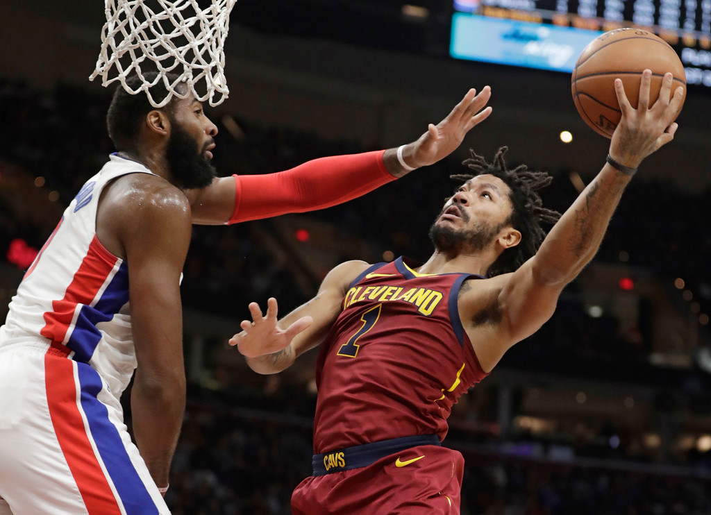 . Cleveland Cavaliers\' Derrick Rose, right, shoots against Detroit Pistons\' Andre Drummond in the first half of an NBA basketball game, Sunday, Jan. 28, 2018, in Cleveland. (AP Photo/Tony Dejak)