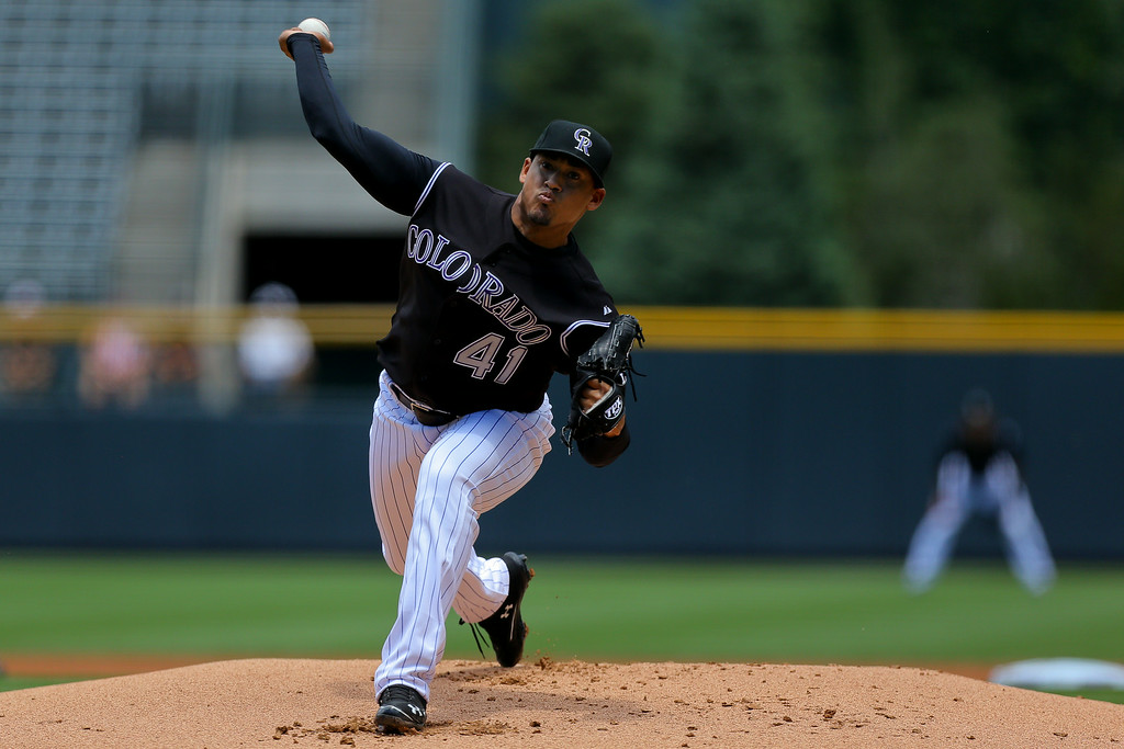 . DENVER, CO - JULY 9:  Jair Jurrjens #41 of the Colorado Rockies delivers to home plate during the first inning against the San Diego Padres at Coors Field on July 9, 2014 in Denver, Colorado. (Photo by Justin Edmonds/Getty Images)