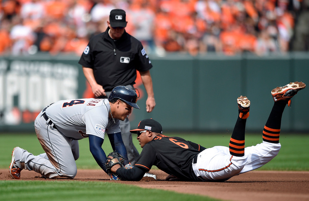 . Baltimore Orioles second baseman Jonathan Schoop, right, tries but can\'t tag Detroit Tigers\' Miguel Cabrera in time as he doubles in the fourth inning of Game 2 in baseball\'s AL Division Series in Baltimore, Friday, Oct. 3, 2014. (AP Photo/Nick Wass)
