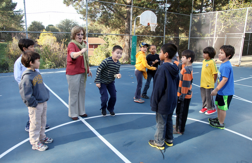 . Suzanne Abbey, Head of K-5 grades at Head Royce School, helps a group of first graders pick equitable teams for a recess kickball game at Head Royce School in Oakland, Calif. on Monday, Dec. 3, 2012.  Head Royce is in it\'s 125th year of operation. (Laura A. Oda/Staff)
