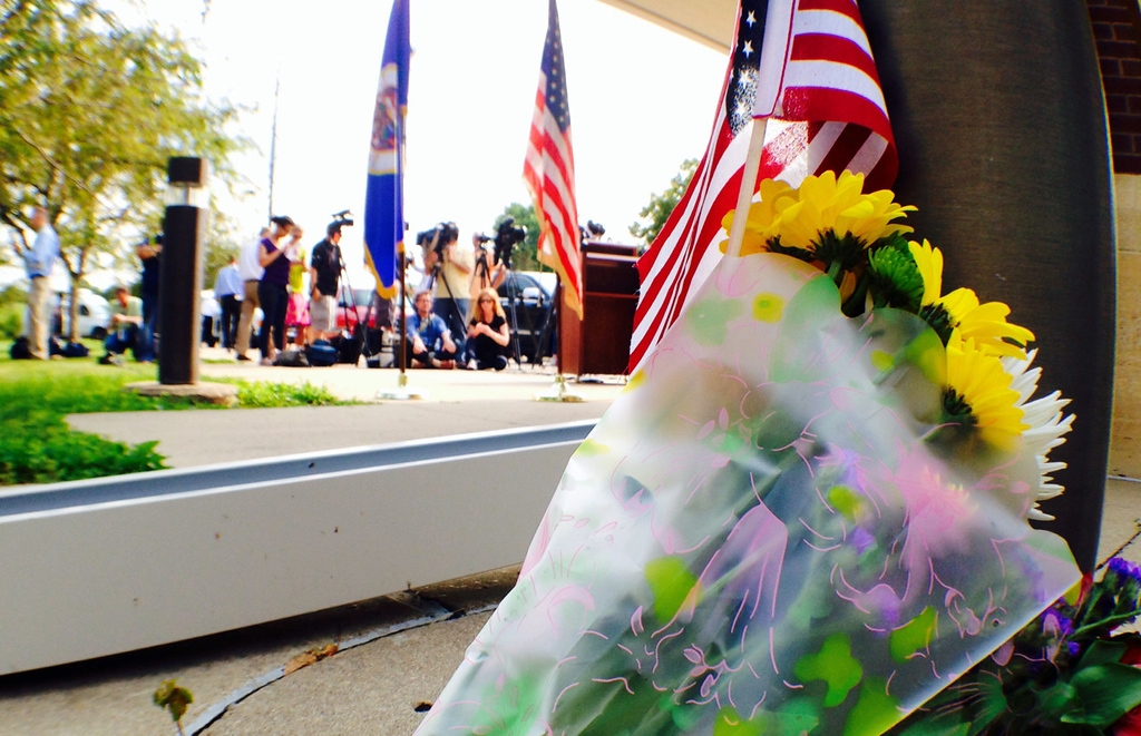 . A bouquet of flowers were placed outside Mendota Heights City Hall at a press conference concerning the shooting death of Officer Scott Patrick on Wednesday, July 30, 2014.  (Pioneer Press: Ben Garvin)