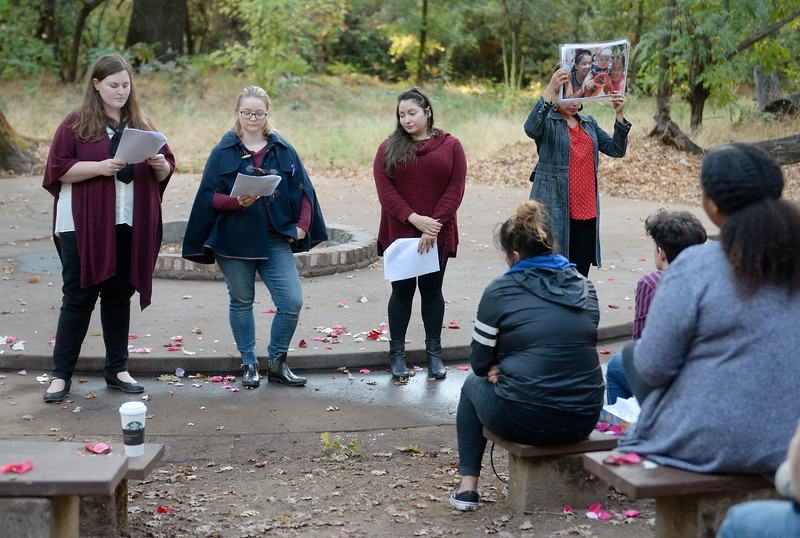"""Speakers share the stories of North State victims of domestic violence during the """"Flowers on the Creek"""" Domestic violence victims remembrance at the One Mile Recreation Area of Bidwell Park in Chico, Calif. Thursday, Oct. 4, 2018.  The program, sponsored by Catalyst Domestic Violence Services, Chico Safe Place, Butte College Safe Place and Wellness Program, and the Butte County Child Abuse Prevention Council is in recognition of October as Domestic Violence Awareness Month. (Bill Husa -- Enterprise-Record)"""