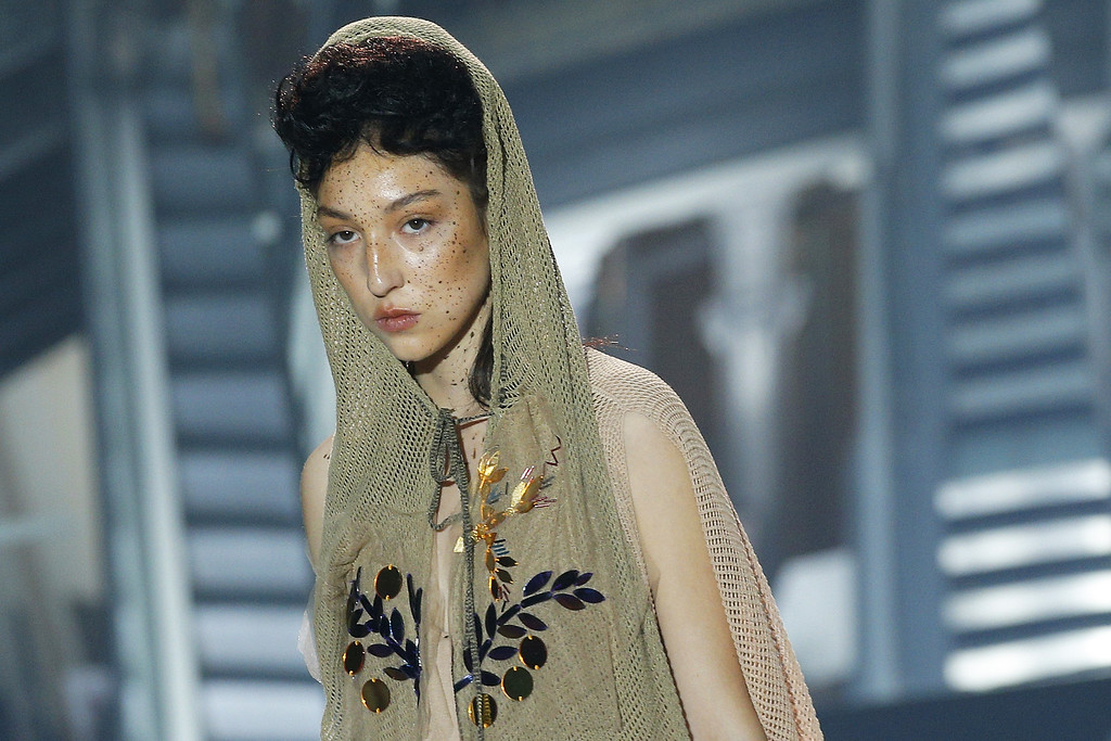 . A model presents a creation as part of Vivienne Westwood\'s ready-to-wear Spring/Summer 2014 fashion collection, presented Saturday, Sept. 28, 2013 in Paris. (AP Photo/Christophe Ena)