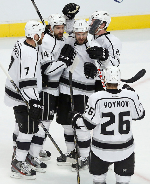 . From left, Los Angeles Kings\' Rob Scuderi (7), Justin Williams, Brad Richardson, Colin Fraser and Slava Voynov celebrate after Williams scored a goal against the Chicago Blackhawks during the first period in Game 1 of the NHL hockey Stanley Cup Western Conference finals Saturday, June 1, 2013, in Chicago. (AP Photo/Charles Rex Arbogast)